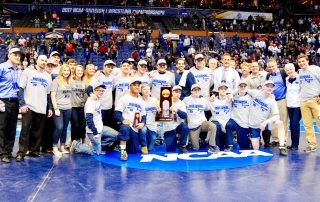 Photo by Marc Billett for PA Power Wrestling Members of the Penn State team pose with the NCAA trophy on Saturday, March 18, 2017.