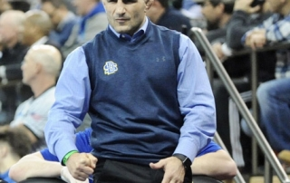 South Dakota State coach Chris Bono reacts during a match at the NCAA Championships in St. Louis.
