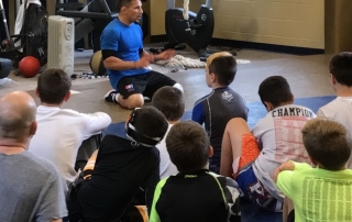 Frank Molinaro talks to wrestlers at a Young Guns clinic in Johnstown on May 6, 2017.